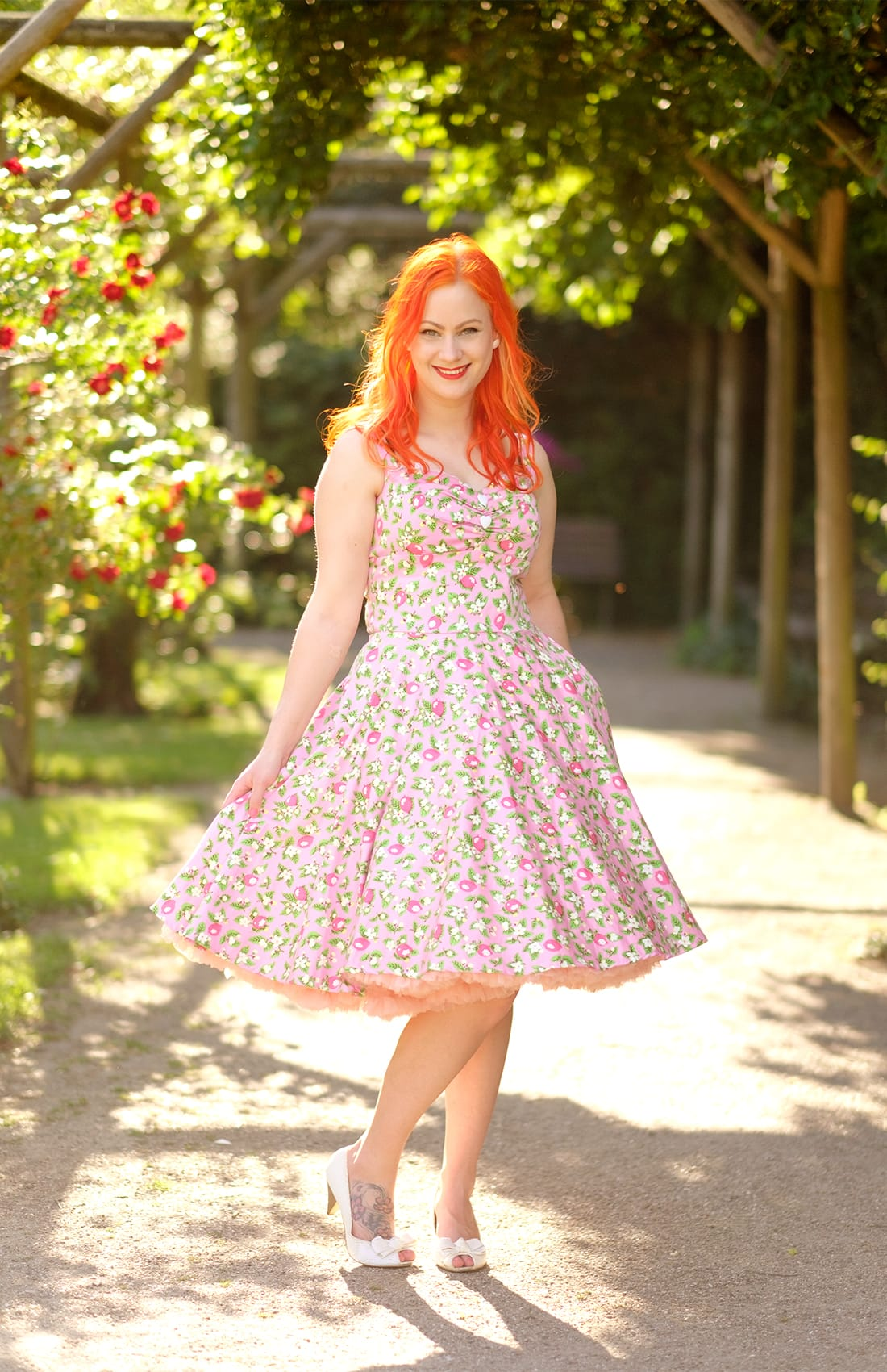 A pretty pink dress from Pinup Girl Clothing and double petticoats