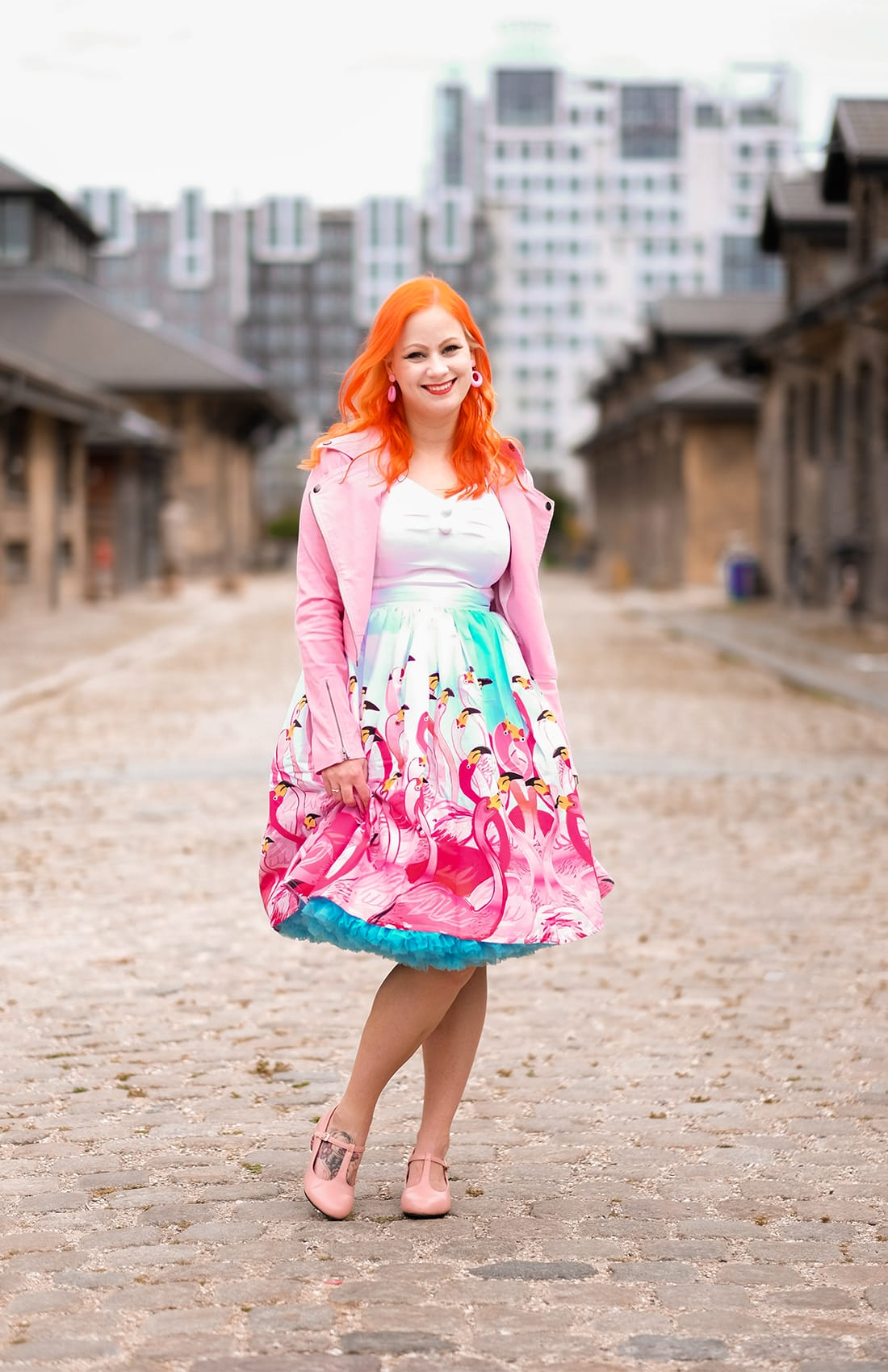 A flamingo skirt from Unique Vintage and a pink biker jacket from Collectif