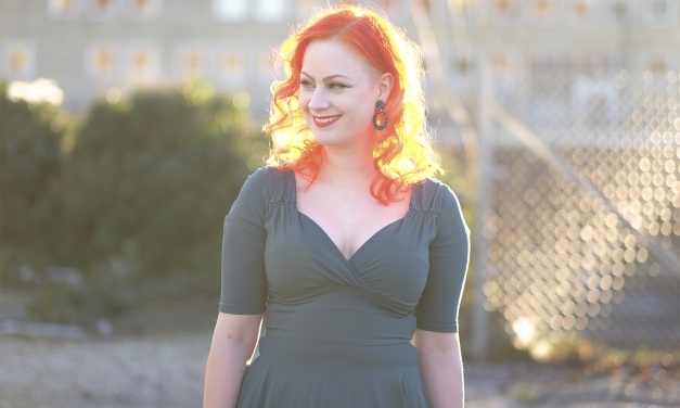 The Collectif Trixie dress in green on a freezing winter day